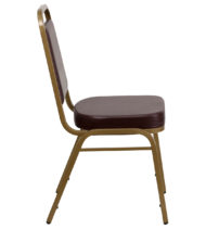 HERCULES Series Trapezoidal Back Stacking Banquet Chair with Brown Vinyl and 2.5'' Thick Seat - Gold Frame -15735